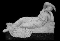 Sculpture The Sleeping Ariadne. Roman Marble statue. Ancient stone white marble woman. Old roman monument . Greek culture exponent in museum