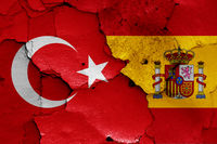 flags of Turkey and Spain painted on cracked wall
