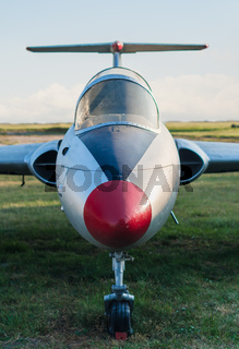 vintage sports plane on grass at the airport closeup on blue sky background