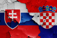 flags of Slovakia and Croatia painted on cracked wall