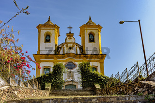 Bottom view of ancient stairs and historic church of 18th century colonial architecture