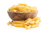 Uncooked penne pasta in bowl. Dried italian pasta