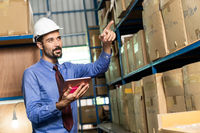 Middle east warehouse manager using tablet do inventory