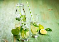 Lemonade drink on a wooden background