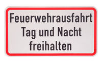 German sign isolated over white. Fire department exit, keep clear day and night