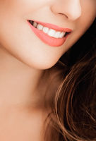Cheerful healthy female smile with perfect natural white teeth, beauty face closeup of smiling young woman, bright lipstick makeup and clean skin for dental and healthcare brand
