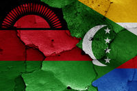 flags of Malawi and Comoros painted on cracked wall