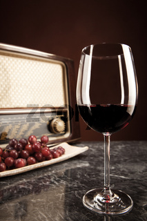 Vintage Radio, grapes and a glass of red wine
