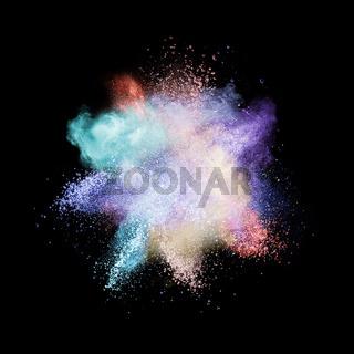 White powder explosion isolated on black