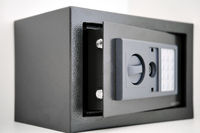 Built into the wall safe with opened door close up view