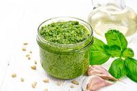 Pesto in jar on white board