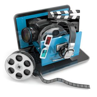 Multimedia concept. Laptop, camera , headphones and video attributes.