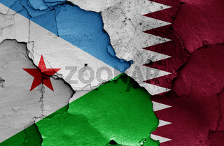 flags of Djibouti and Qatar painted on cracked wall