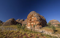 Dome of rocks at a hiking trip at the Australian outback between with blue sky at the morning light – Western Australia