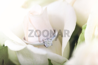 Engagement ring with diamond on rosebud
