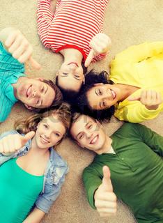 group of smiling people lying down on floor
