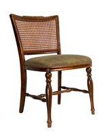 Retro wooden french cane back dining chair isolated on white including clipping path