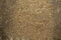 Brick wall of an old ashlar castle.