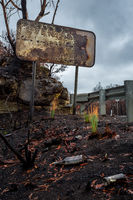 Burnt road sign, rubbish and landscape after bush fires Australia