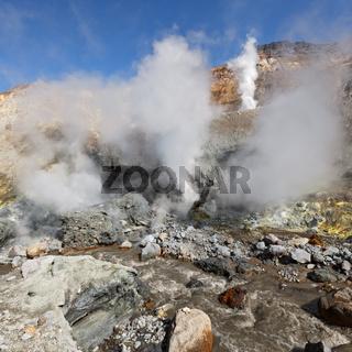 Hot springs, fumaroles in thermal field in crater active Mutnovsky Volcano on Kamchatka Peninsula