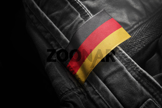Tag on dark clothing in the form of the flag of the Germany