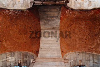 Red brick vault. Ceiling. Circular pattern.Architectural Texture