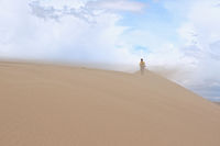 Tourist Walking Along the Edge of the Sand Dune.