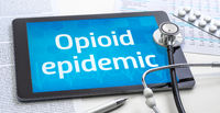 The word Opioid epidemic on the display of a tablet
