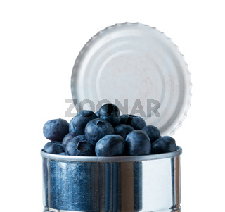 Blueberries bursting out of tin can