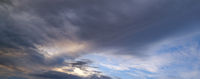 Fluffy clouds in evening overcast sky panoramic view. Climate, environment and weather concept sky background.