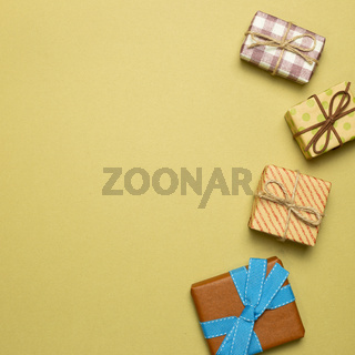 Colorful gift boxes on khaki background. top view, copy space