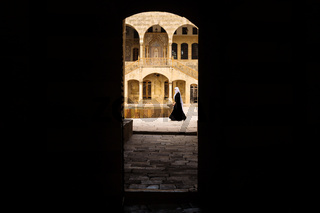 View trough entrance tunnel with lady passing by at Emir Bachir Chahabi Palace Beit ed-Dine in mount Lebanon Middle east, Lebanon