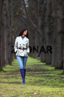 woman walk in autumn park