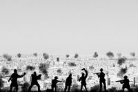 War concept. Military silhouettes fighting scene  background, Civil war soldiers silhouettes attack scene in a arab desert town.