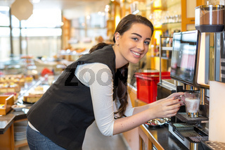 Waitress in café or restaurant and coffee machine