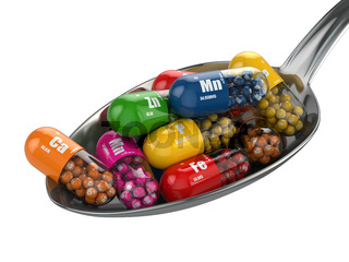Dietary supplements. Variety pills. Vitamin capsules on the spoon.