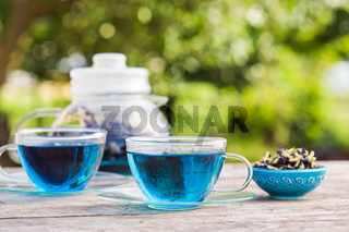 Tea ceremony with blue Thai tea anchan outdoors