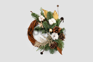 Christmas wreath on grey background. Handmade christmas decoration in golden color.