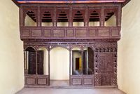 Oriental arabesque decorations with balcony installed front of open doors inside empty spacious room