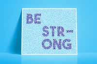 textured card with the word be strong