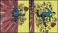 Businessman breaks through a brick wall