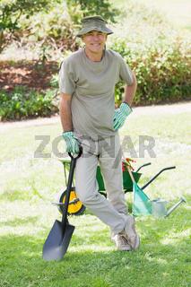 Male gardener with spade at garden