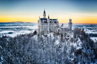 Neuschwanstein Castle at sunset in winter landscape. Germany