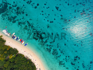 Beach corals and sea on tropical island