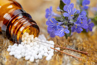 alternative medicine with acupuncture and herbal pills