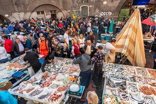 Catania, Italy - May 11, 2019: La Pescheria, the famous historical fish market in Catania, Sicily.
