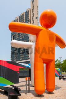 Argentina Cordoba embracing orange puppets in Capitalinas district