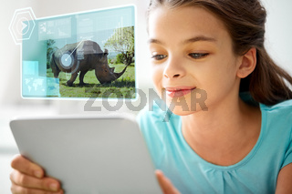 girl with tablet pc learning nature online at home