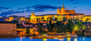 View of Hradcany district in Prague with St. Vitus Cathedral and Prague Castle after sunset. Czech Republic