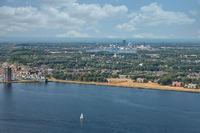 Aerial view Dutch city Almere between lakes Markermeer and Gooimeer